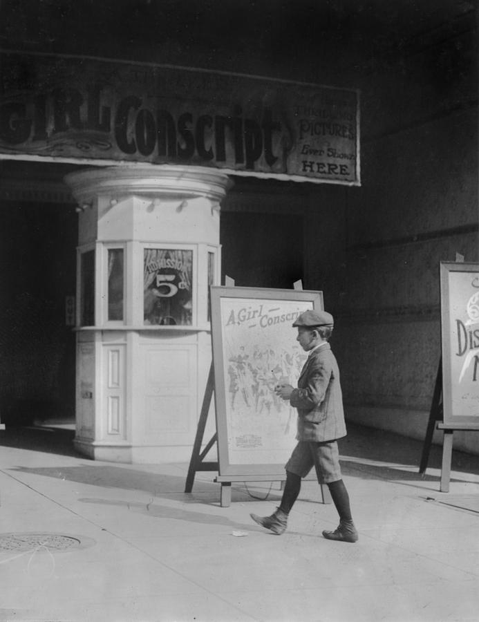 1910s Photograph - Boy In Front Of A Movie Theater Showing by Everett
