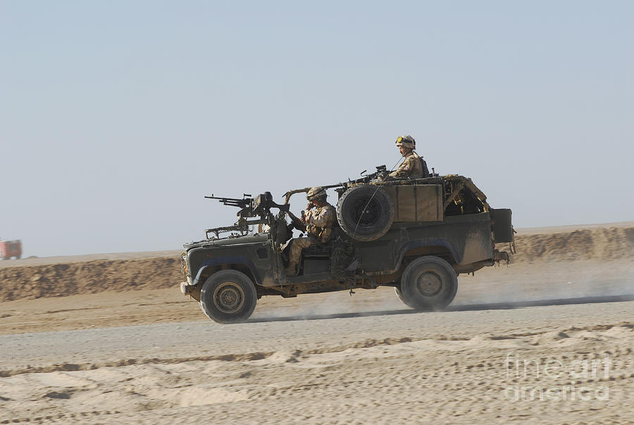Armament Photograph - British Soldiers Patrol Afghanistan by Andrew Chittock