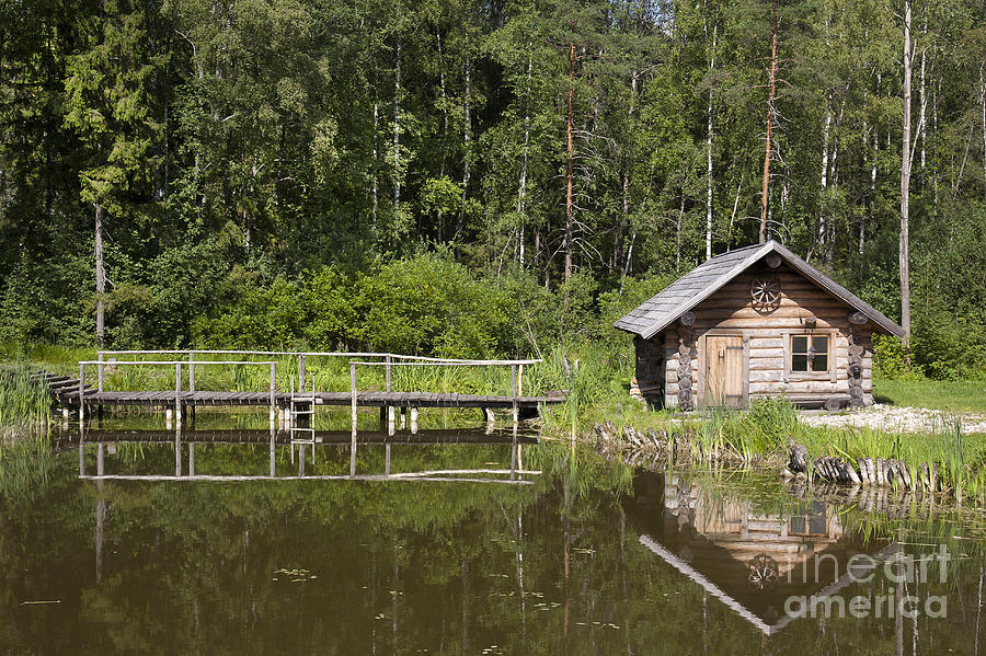 cabin near the water photograph by jaak nilson