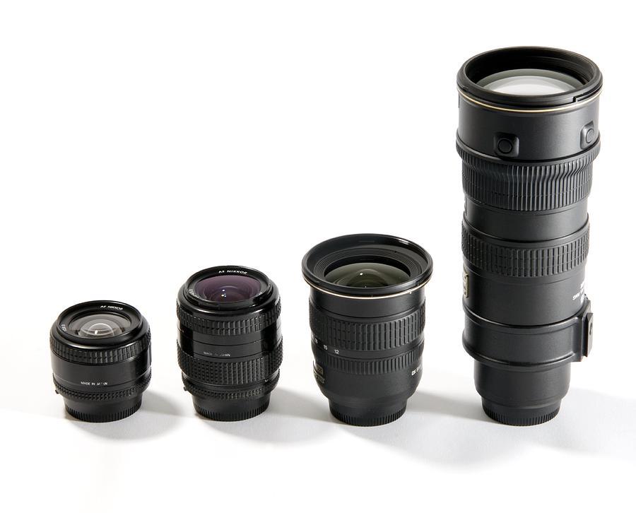 Nikon Photograph - Camera Lenses by Johnny Greig