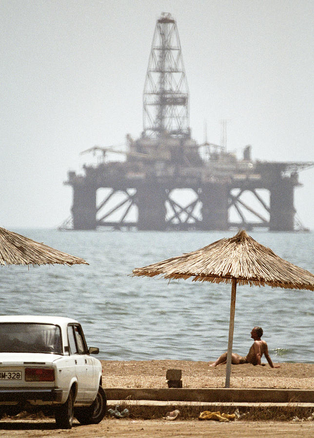 Beach Umbrella Photograph - Caspian Sea Oil Rig by Ria Novosti