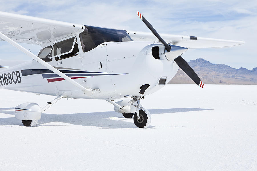 No People Photograph - Cessna Aircraft On Bonneville Salt Flats by Paul Edmondson