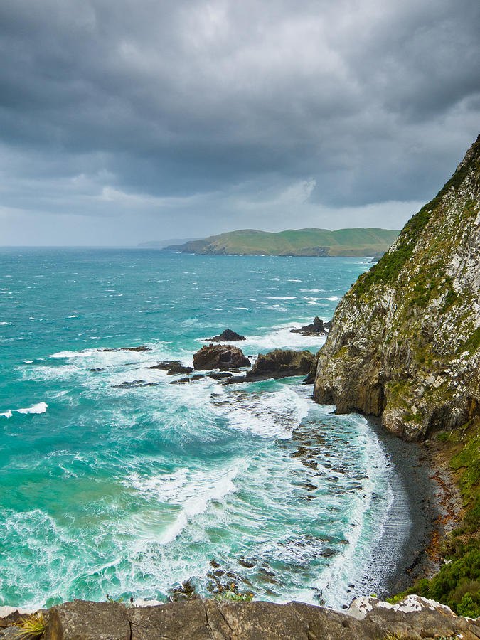 Background Photograph - Cliffs Under Thunder Clouds And Turquoise Ocean by Ulrich Schade