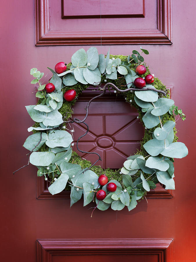 Close Up Of Christmas Wreath On Door By Carlsson Peter