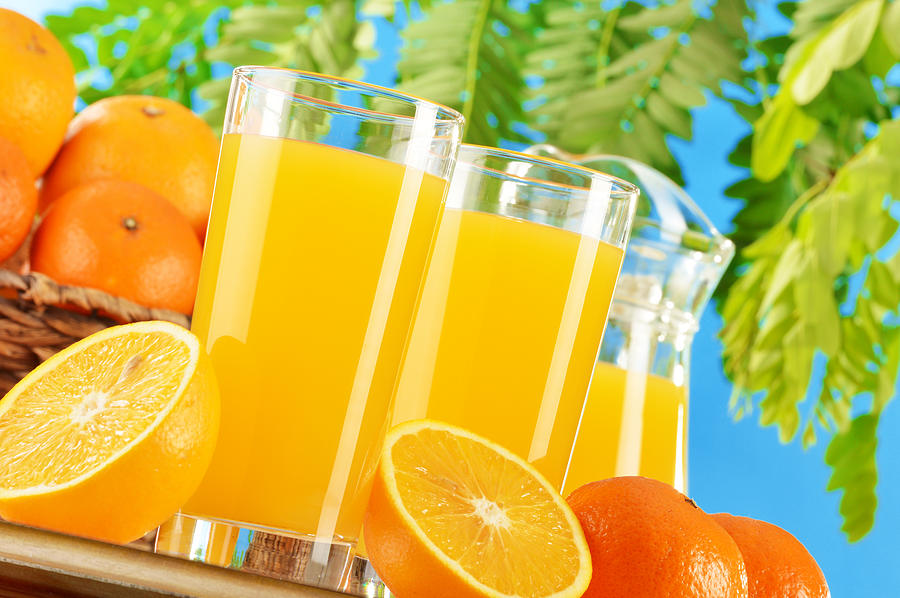 Juice Photograph - Composition With Two Glasses Of Orange Juice And Fruits by T Monticello
