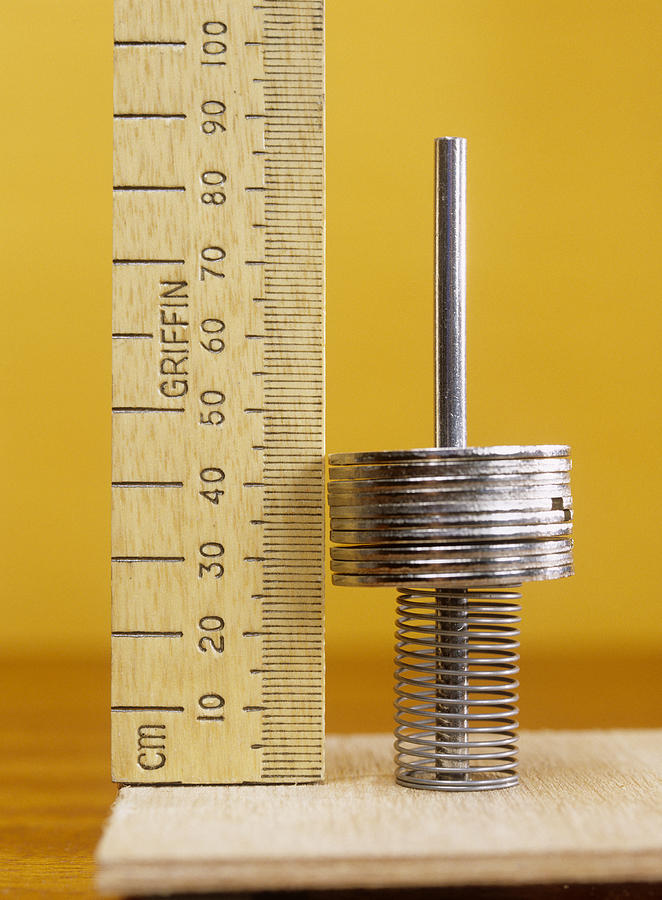 Weight Photograph - Compressed Spring by Andrew Lambert Photography