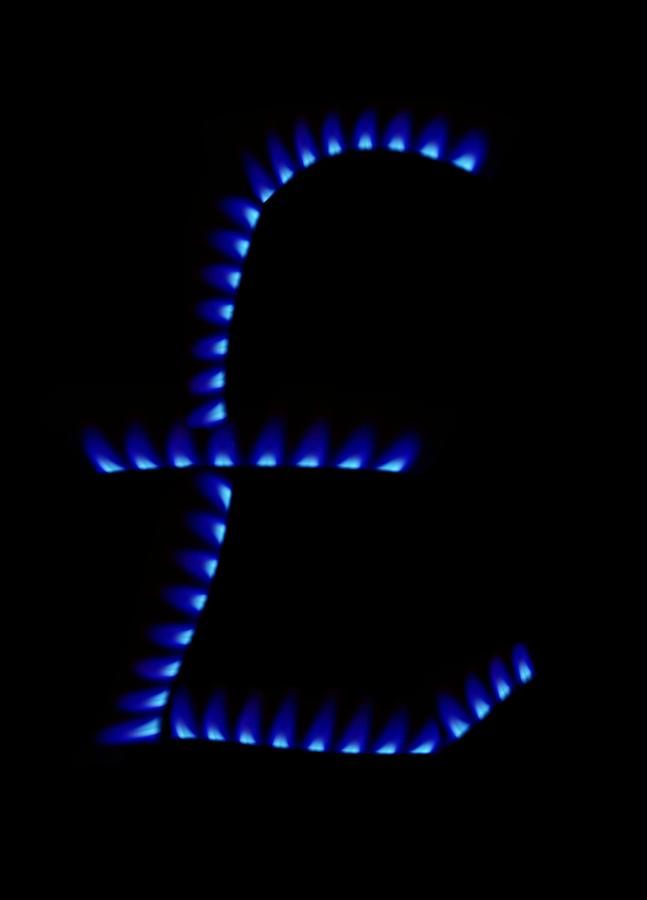 Black Background Photograph - Cost Of Gas, Conceptual Image by Victor De Schwanberg