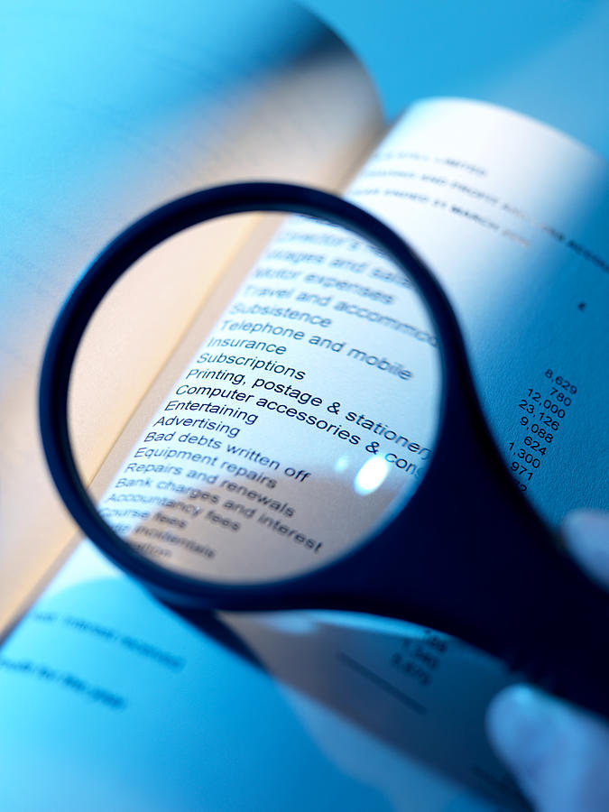 Magnifying Glass Photograph - Financial Paperwork by Tek Image