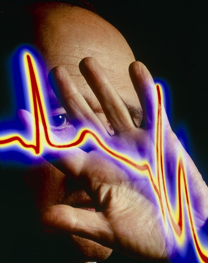 Ecg Photograph - Heart Disease: Hand Held Up To Irregular Ecg Trace by Mehau Kulyk
