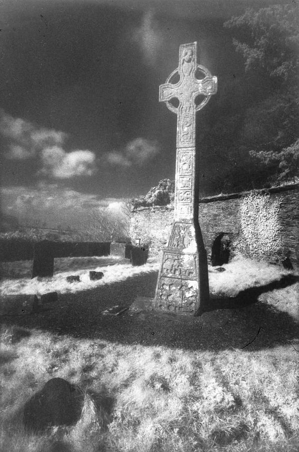 Monument; Stone; Carving; Carved; Shadows; Shadow; Irish; Landscape; Churchyard; Graveyard; Tombstones; Gravestones; Graves; Celtic; Eerie; Atmospheric; Misty; Mist; Solitary Photograph - High Cross by Simon Marsden