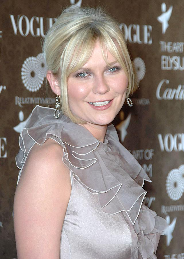 Gala Photograph - Kirsten Dunst Wearing A Valentino Gown by Everett