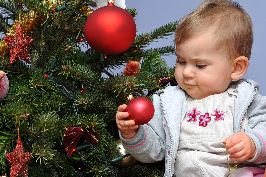 Little Baby And Christmas Tree Photograph by Waldek Dabrowski