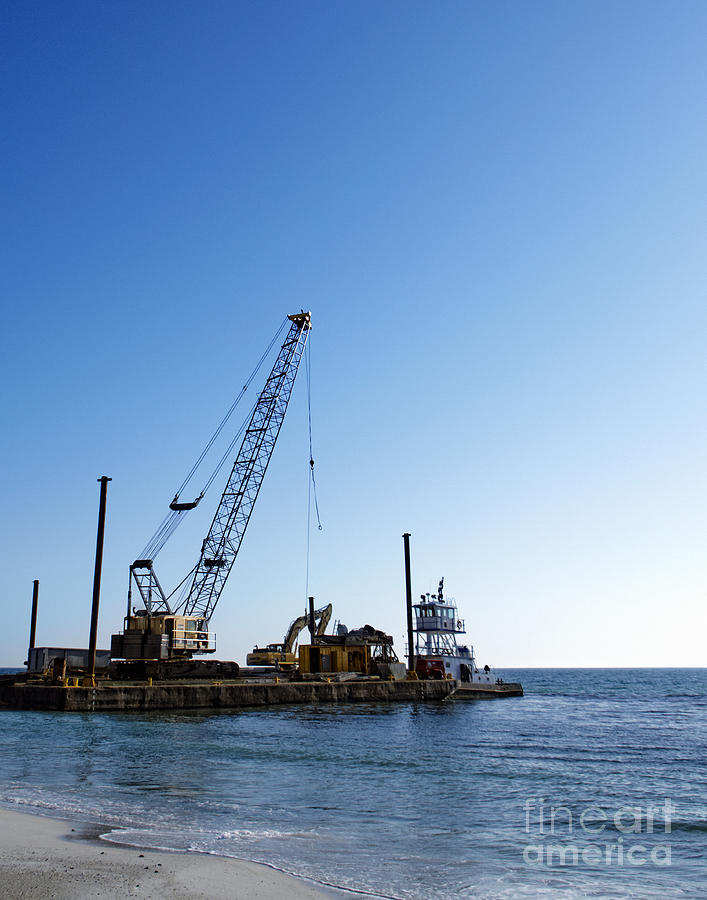 Beach Photograph - Machinery Cleaning Up A Pier by Skip Nall