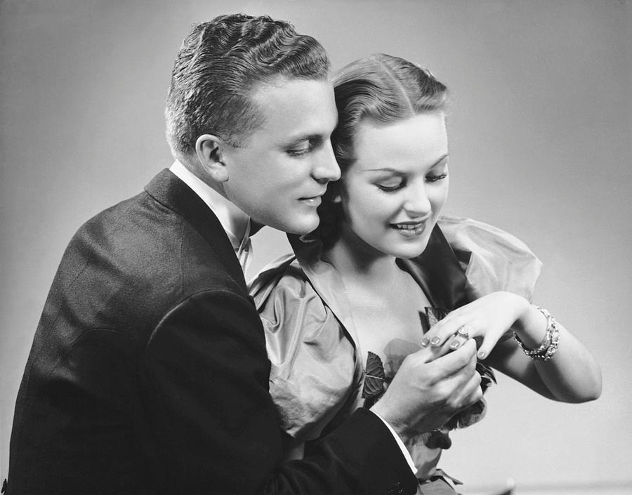 Adult Photograph - Man Putting Ring On Womans Finger by George Marks