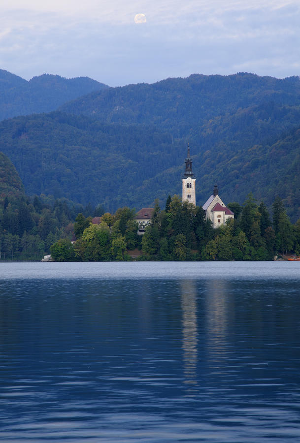 Bled Photograph - Moon Setting At Sunrise Over Island Church At Lake Bled by Ian Middleton