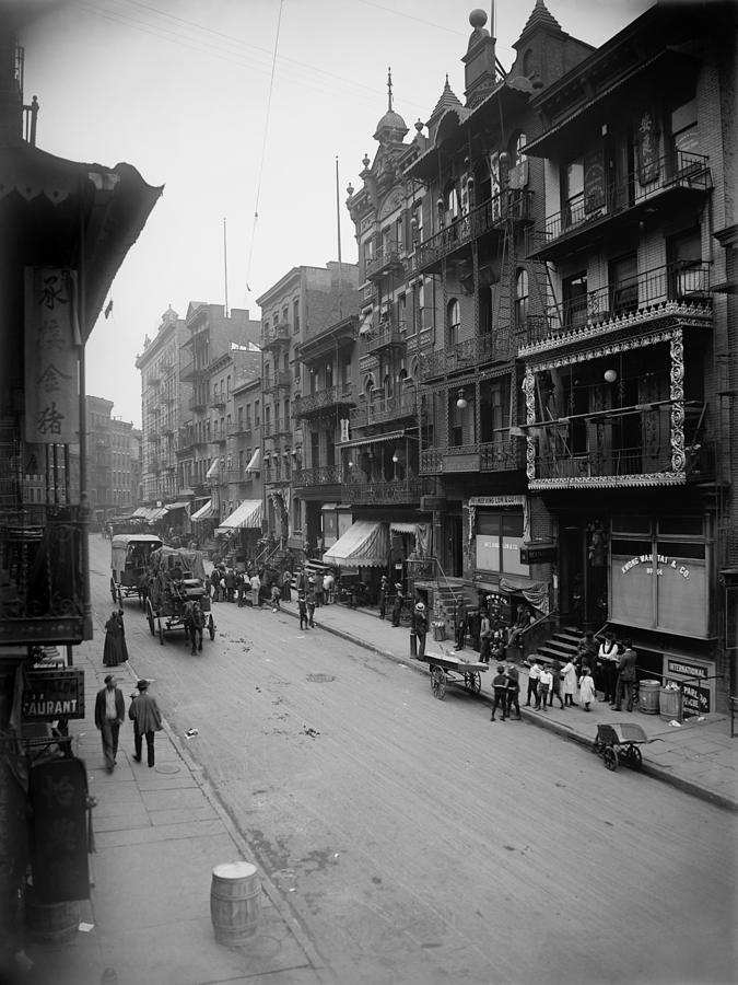 History Photograph - Mott Street In New York Citys Chinatown by Everett