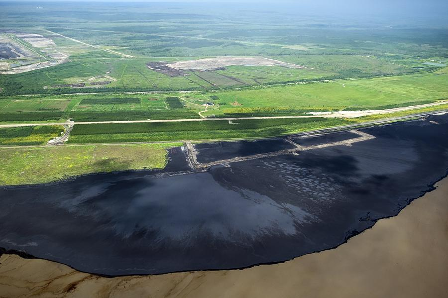 Oil Photograph - Oil Plant Settling Pond by David Nunuk