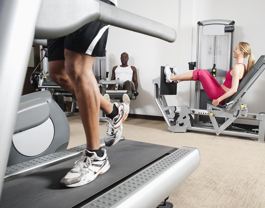 30-34 Years Photograph - People Exercising In Health Club by Erik Isakson