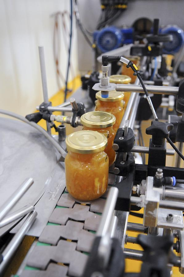 Bottle Photograph - Preserve And Jam Bottling Production Line by Photostock-israel