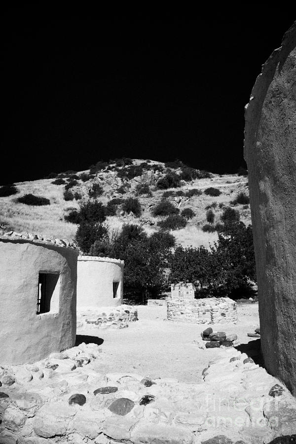 Ancient Photograph - reconstruction of Choirokoitia ancient neolithic village settlement republic of cyprus by Joe Fox