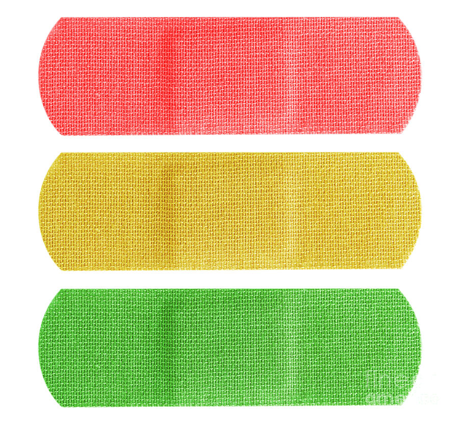 Bandaid Photograph - Red Yellow And Green Bandaids by Blink Images