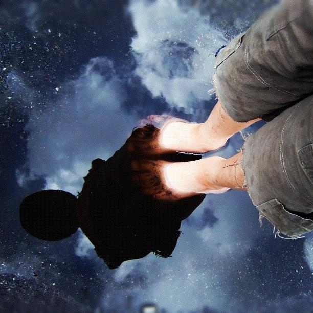 Reflection Photograph - Reflection of boy in a puddle of water by Matthias Hauser