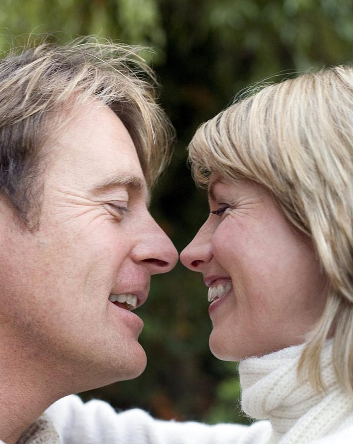 Human Photograph - Smiling Couple Embracing by Ian Boddy