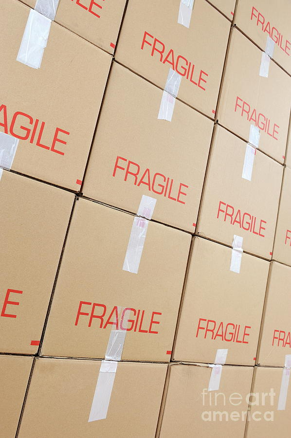 Conformity Photograph - Stacks Of Cardboard Boxes Marked fragile by Sami Sarkis