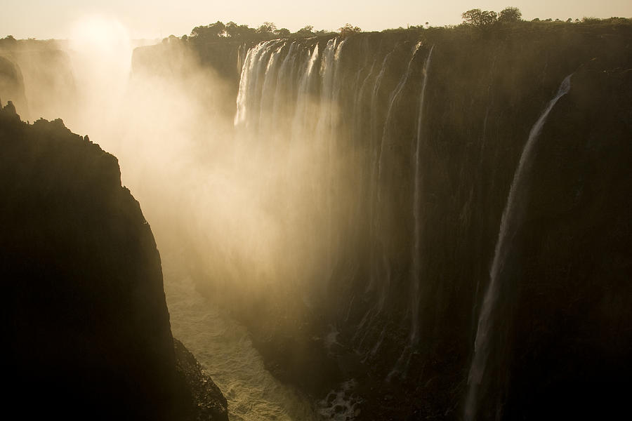 Africa Photograph - Sunlight Illuminates Mist Rising by Ralph Lee Hopkins