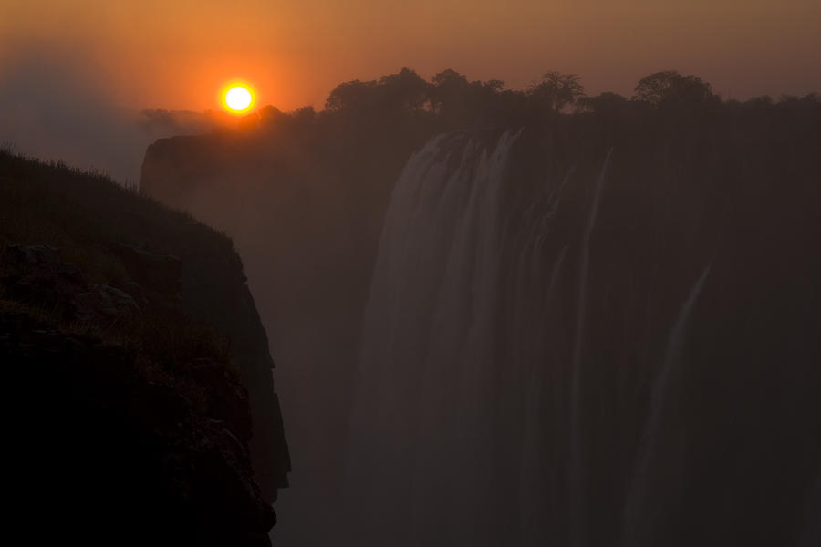 Africa Photograph - Sunset Over Cascading Victoria Falls by Ralph Lee Hopkins
