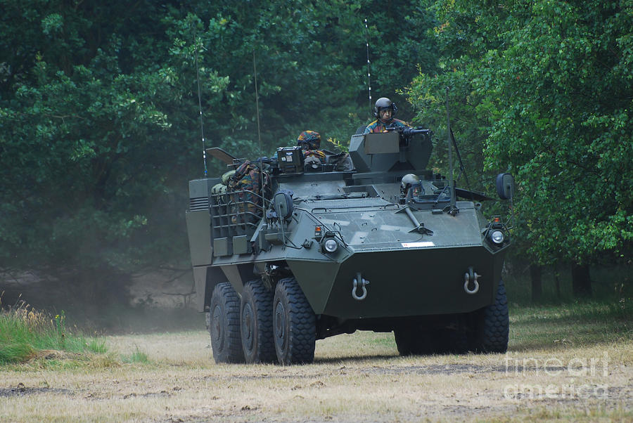 Military Photograph - The Pandur Recce Vehicle In Use by Luc De Jaeger