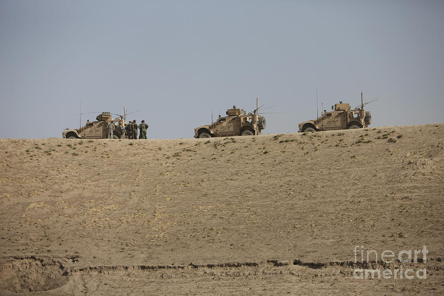 Armor Photograph - Three M-atvs Guard The Top Of The Wadi by Terry Moore