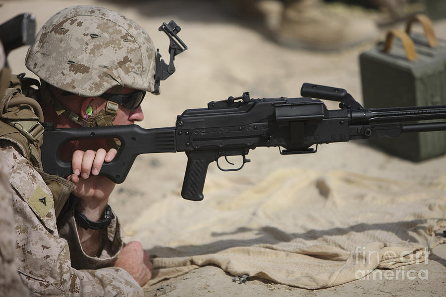 Machine Guns Photograph - U.s. Marine Prepares To Fire A Pk by Terry Moore