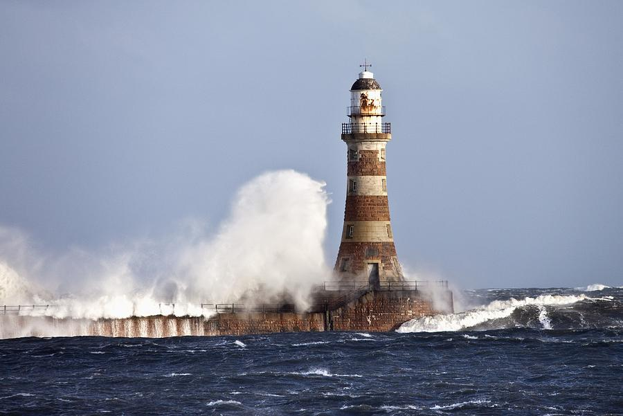 Waves Crashing Against Roker Lighthouse Photograph By John