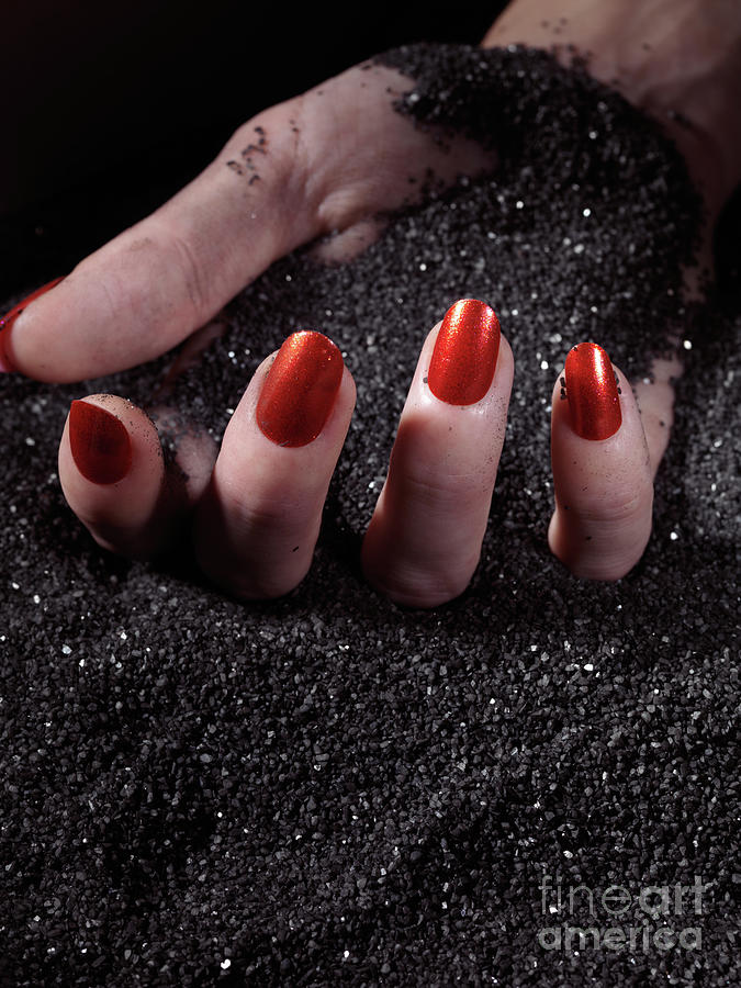 Manicure Photograph - Woman Hand With Red Nails On Black Sand by Maxim Images Prints