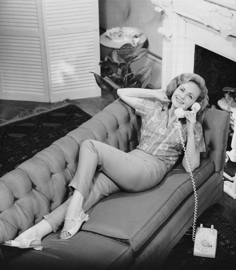Adult Photograph - Woman Talking On Telephone by George Marks