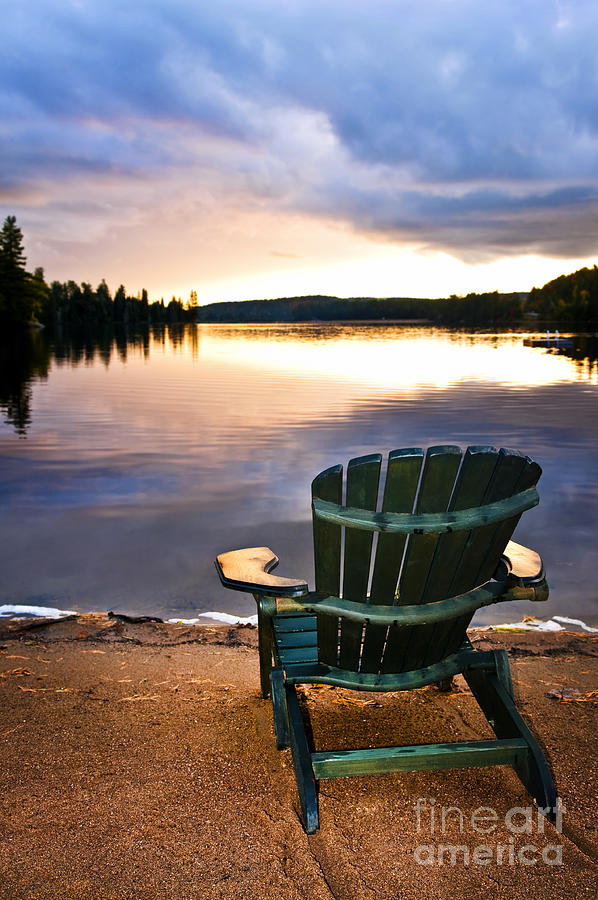 Lake Photograph - Wooden Chair At Sunset On Beach by Elena Elisseeva