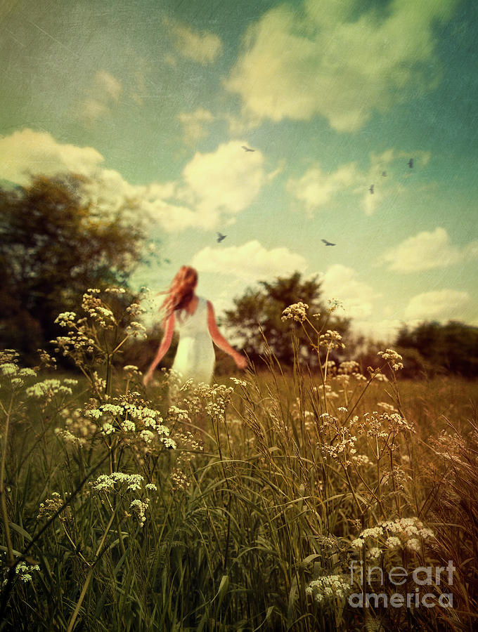 Alone Photograph - Young Girl Walking In Field Of Flowers by Sandra Cunningham