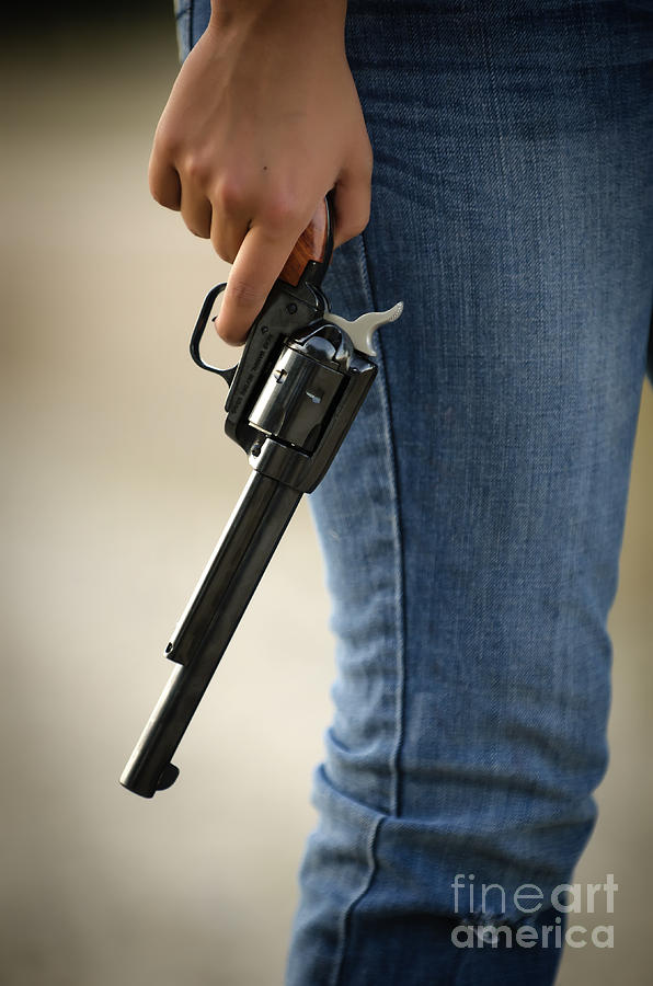 Young Woman Carrying Gun Photograph By Andre Babiak
