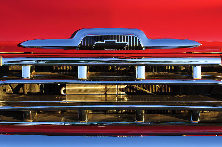 Grill Photograph - 1957 Chevrolet Pickup Truck Grille Emblem by Jill Reger