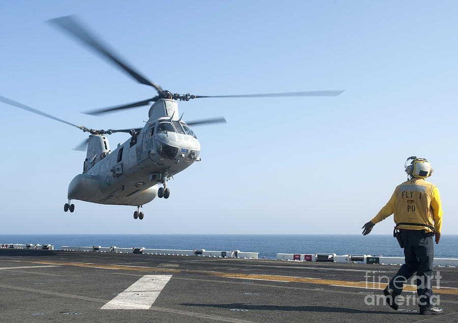 Uss Makin Island Photograph - A Ch-46e Sea Knight Helicopter Prepares by Stocktrek Images