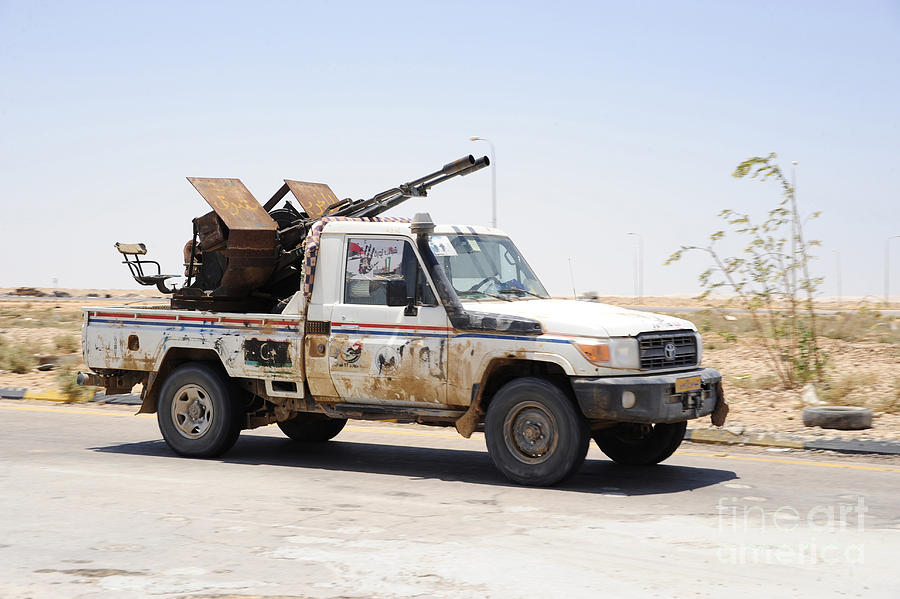 Benghazi Photograph - A Free Libyan Army Pickup Truck by Andrew Chittock