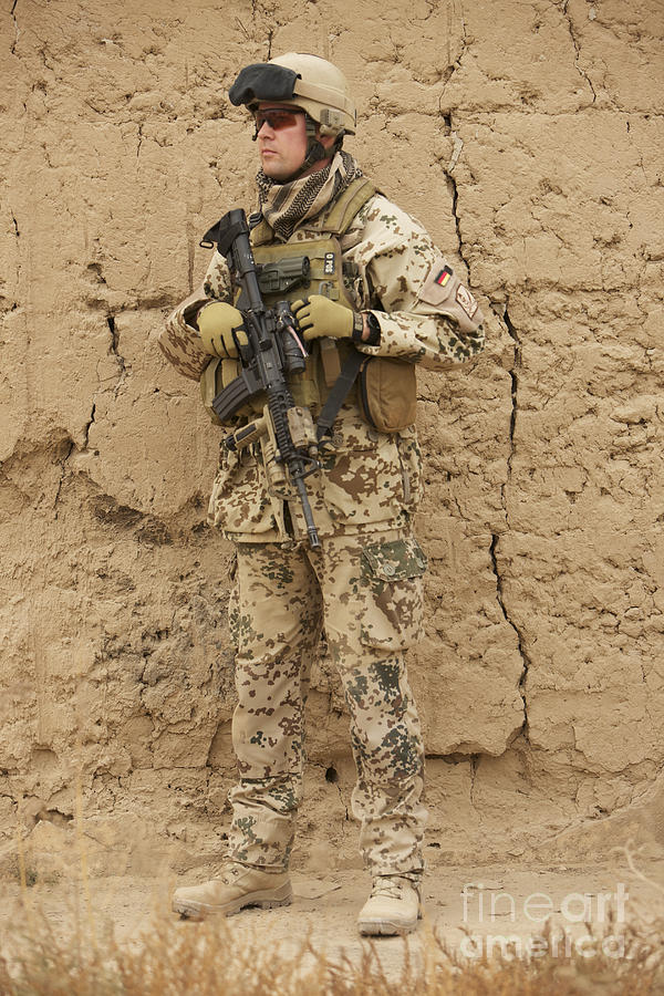 Portrait Photograph - A German Army Soldier Armed With A M4 by Terry Moore