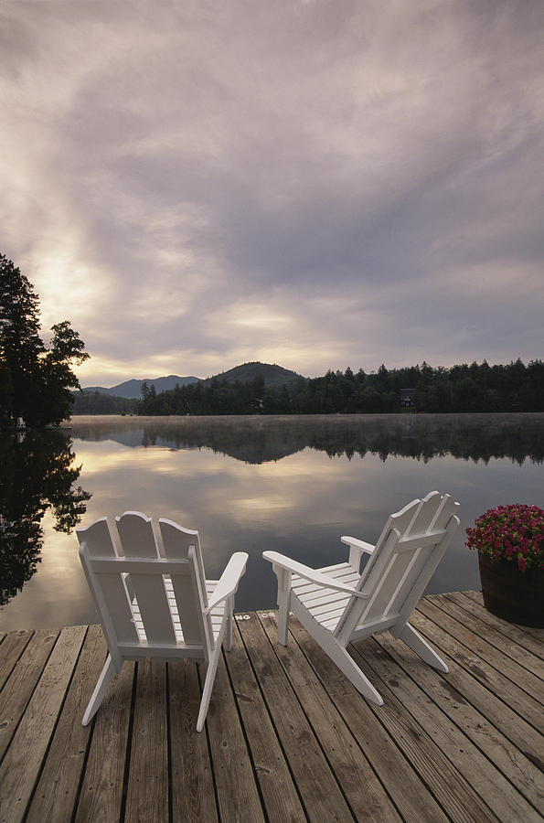 A Pair Of Adirondack Chairs On A Dock Photograph By
