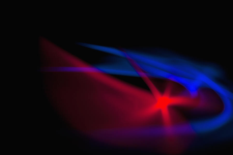 abstract patterns of blue and red light on a black background