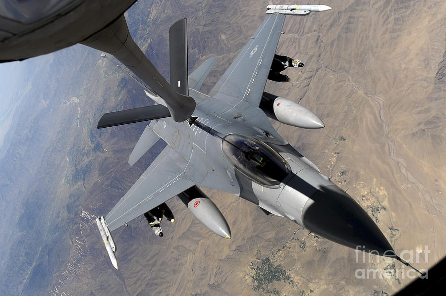 Afghanistan Photograph - An F-16 Fighting Falcon Receives Fuel by Stocktrek Images