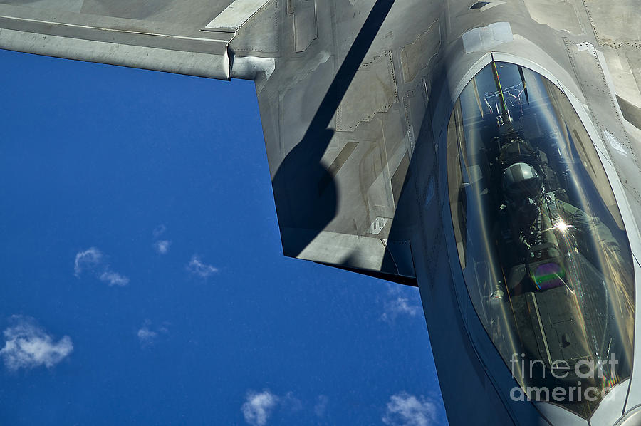 Military Photograph - An F-22 Raptor In Flight by Stocktrek Images