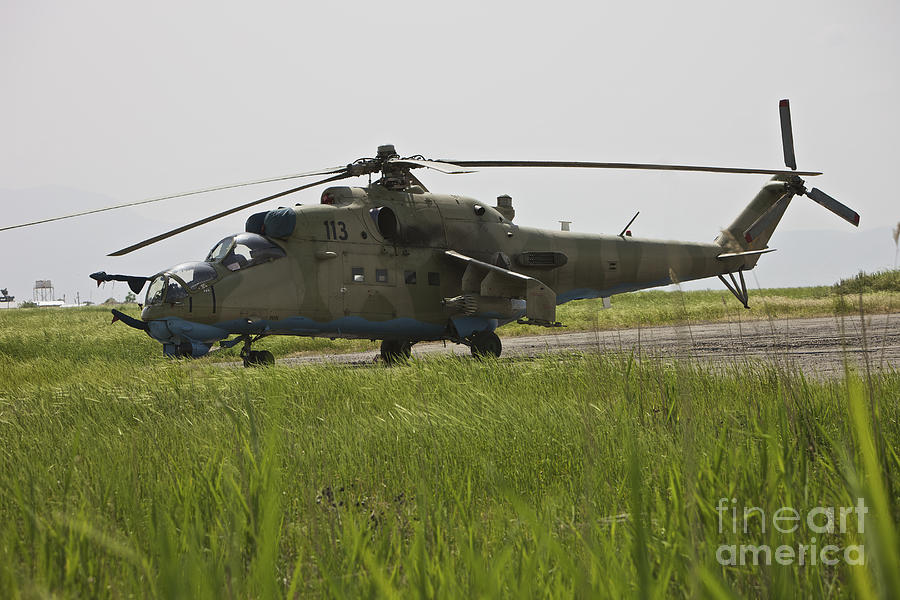 Airfield Photograph - An Mi-35 Attack Helicopter At Kunduz by Terry Moore