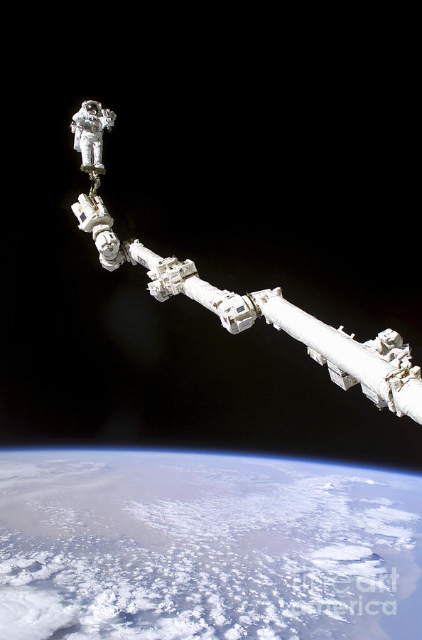 Adults Only Photograph - Astronaut Anchored To A Foot Restraint by Stocktrek Images