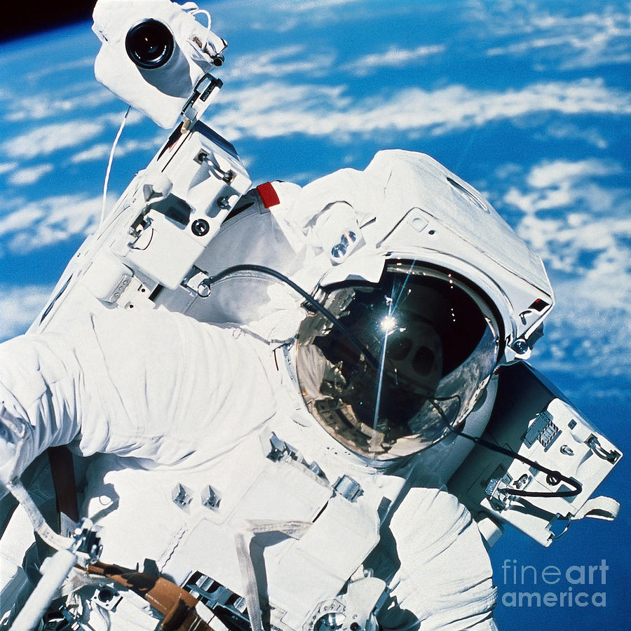 an astronaut floating in space - photo #24